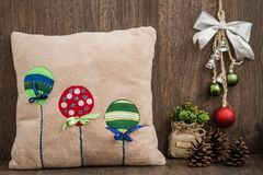 Handmade Pillow with  Baloon Pattern on Wooden Background. Handmade pillow with  baloon pattern on brown wooden background Stock Images