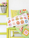 Handmade pillow and blanket on the chair Royalty Free Stock Photos