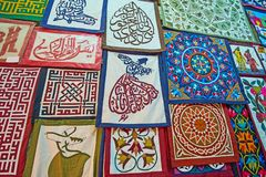 The handmade pillowcases in Tentmakers alley, Cairo, Egypt. Beautiful pillowcases in stall of Tentmakers alley Sharia Khayamiya Bazaar with patchwork, embroidery stock photos
