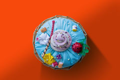 Handmade Pilow Cake top view, red orange background Royalty Free Stock Photos