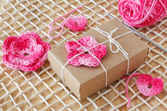 Handmade pink crochet flowers and heart for decoration of gift Stock Photography