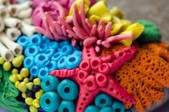 Handmade plastelina wystrój z rafa koralowa mieszkanami, rozgwiazda, anemon Zamyka w górę fotografii rzemiosło obraz royalty free