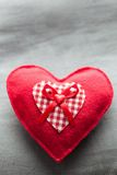 Handmade plush red heart on the soft pillow Stock Images