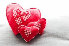Handmade plush red hearts Stock Photo