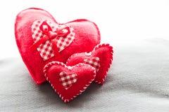 Handmade plush red hearts Stock Photo
