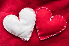 Handmade plush red hearts couple Stock Image