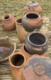 Handmade pots on a floating island Uros. Hanmade pots sold on a floating island Uros near Puno in Peru Stock Photos