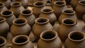 Handmade pots in India. A high angle shot of a dozen handmade pots in India stock video