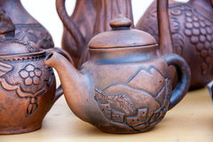 Handmade pottery on display at street market in Crimea Royalty Free Stock Photos