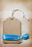 Handmade Price Tag with Blue Ribbons Royalty Free Stock Photo