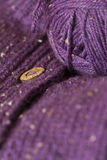 Handmade purple cardigan with wooden buttons Royalty Free Stock Photo