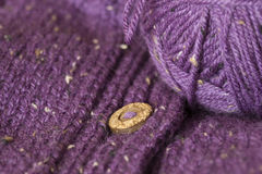 Handmade purple cardigan with wooden buttons Stock Photo