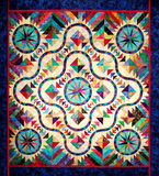 Handmade Quilt. A handmade quilt in stained glass pattern stock photography
