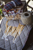 Handmade quilt blanket with cat on wooden table with twine and sewing tools Royalty Free Stock Photography