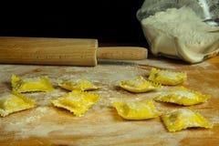 Handmade ravioli preparation. Some just made ravioli pasta Royalty Free Stock Images