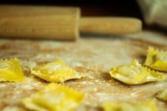 Handmade ravioli preparation. Some just made ravioli pasta Royalty Free Stock Photos
