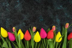 Handmade and real tulips on darken Royalty Free Stock Images