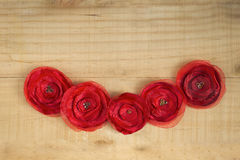Handmade red fabric flower on wood background Stock Image