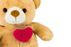 Handmade red heart knitting with Cute Teddy Bear on white background.Valentine`s day or love concept. stock photography