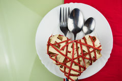Handmade red heart on plate Stock Photo