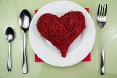 Handmade red heart on plate Stock Image