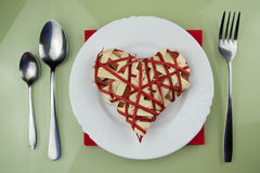 Handmade red heart on plate Royalty Free Stock Photo