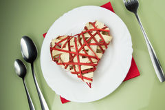 Handmade red heart on plate Royalty Free Stock Photography
