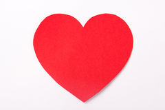 Handmade red paper heart over white stock images