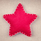 Handmade  red star on a fabric background Royalty Free Stock Image