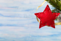 Handmade red star on light blue background Stock Photo