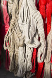 Handmade red and white colored halters for riders for sale at fa Royalty Free Stock Image
