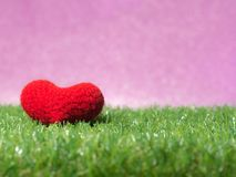 Handmade red yarn heart on Green grass background is royal pink.Copy space for text, Valentines day, love concept and love backg. Round royalty free stock photo