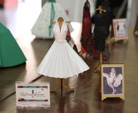 Exhibition of miniature dresses made of paper by Brazilian artist Helena Kavano - Sao Paulo - June 2019. Handmade replicas of famous dresses from Hollywood stock photography