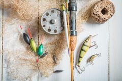 Handmade retro equipment for angler with net, floats and rods. Retro style stock images