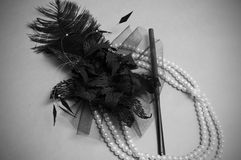 Handmade retro hair ornament. From feathers necklace and a tube for cigarettes Stock Images