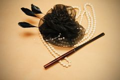 Handmade retro hair ornament. From feathers necklace and a tube for cigarettes Royalty Free Stock Photos