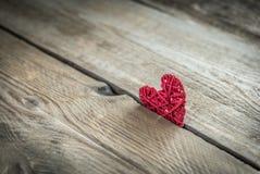 Handmade retro heart on the wooden background Royalty Free Stock Photo