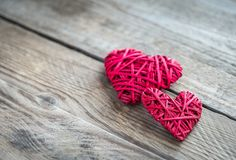 Handmade retro hearts on the wooden background Stock Images