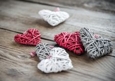 Handmade retro hearts on the wooden background Stock Photos