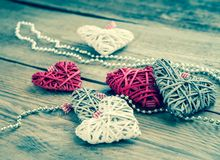 Handmade retro hearts on the wooden background Royalty Free Stock Image
