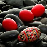 Handmade romanian decorated easter egg Stock Photos