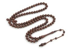 Handmade rosewood rosary beads isolated on white. Handmade rosewood rosary prayer beads isolated on white background. Islamic religious symbol object stock images