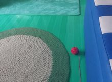 Handmade carpet, knitting ball on the floor in the small room royalty free stock image