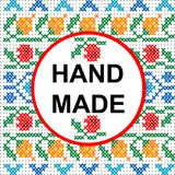 Handmade round frame over a colored cross stitch pattern royalty free illustration