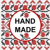 Handmade round frame over a cross stitch pattern Royalty Free Stock Photography