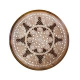 Handmade round wooden pattern. Ornamental circle floral decor panel with metal incrustation. Hadcraft vintage stool. Top view. Iso. Lated on white royalty free stock image