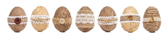 Handmade rustic Easter eggs and bunnies against wood Stock Image