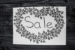 Handmade sale sign on wooden background royalty free stock photo
