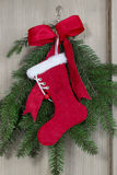 Handmade Santa boot on pine branch background for christmas Royalty Free Stock Photo