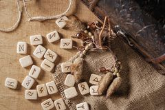 Handmade scandinavian wooden runes on a wooden vintage background. Concept of fortune telling and prediction of the royalty free stock photo